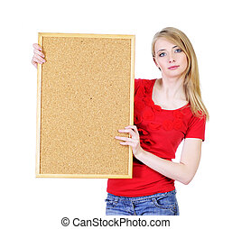 Pretty young blond woman holding a cork board isolated on white looking straight