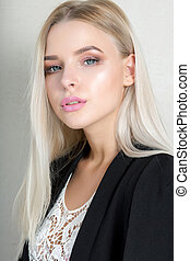 Pretty young blonde girl with pink lips and long straight hair