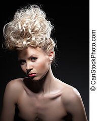 Pretty young blonde woman in studio