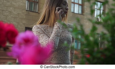 Pretty young blonde woman talking on mobile phone