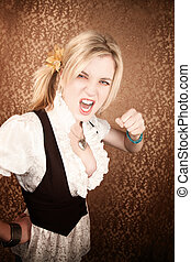 Pretty young blonde woman throwing a punch