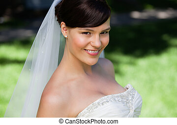 Pretty young bride smiling