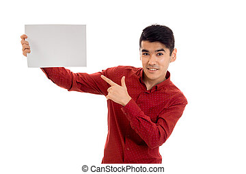 pretty young brunette man in red t-shirt with placcard in his hands isolated on white background