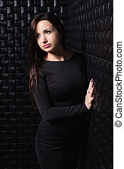 Pretty young brunette posing in the studio.