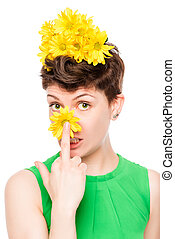 pretty young brunette with flowers in the studio on a white background