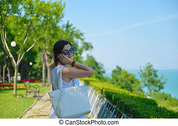 young business woman using mobile phone outdoor