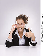 Pretty young business woman with thumb up
