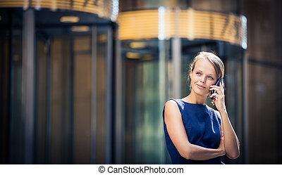 Pretty, young businesswoman talking on the phone