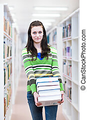 pretty, young college student in a library