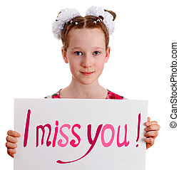 """Pretty young cute kid girl holding board with a text """"I miss you"""", studio portrait against white background, isolated"""