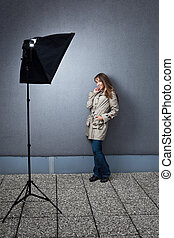 Pretty young female caucasian model being photographed