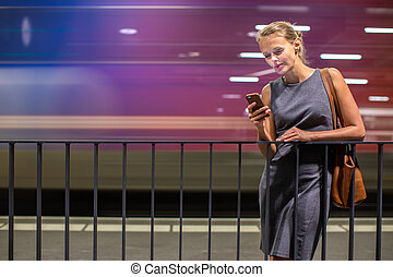 Pretty, young female commuter waiting for her daily train