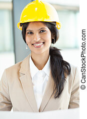 pretty young female construction worker