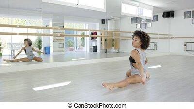 Pretty young female dancer in studio
