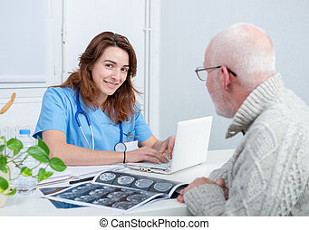 young female doctor in the office with her patient