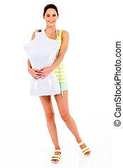 fashion designer holding mannequin