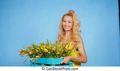 Pretty Young female florist with box of tulips - Young...