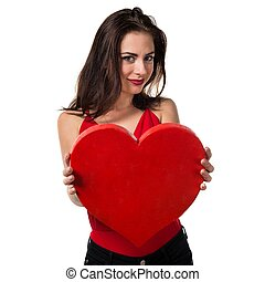 Pretty young girl holding a heart