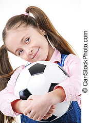 Pretty young girl holding a soccer ball