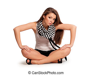 pretty young girl in a blouse sitting on the floor