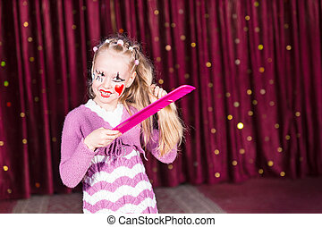 Pretty young girl in a pink pantomime costume