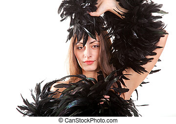 Pretty young girl in black boa isolated on white