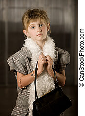 Pretty young girl with blue eyes wearing dressup clothes