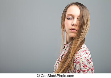 pretty young girl in studio