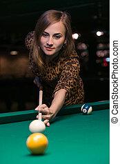 girl is playing billiard