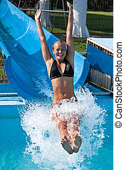Pretty young girl joy in the water slides
