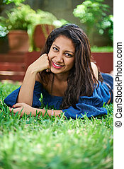 pretty young girl laying on grass