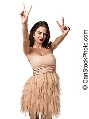 Pretty young girl making victory gesture