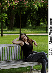 pretty young girl on a bench
