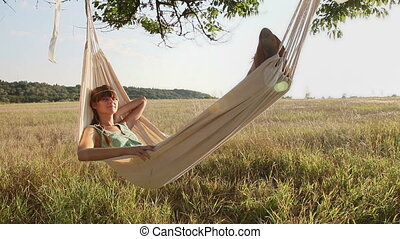 Pretty young girl on hammock