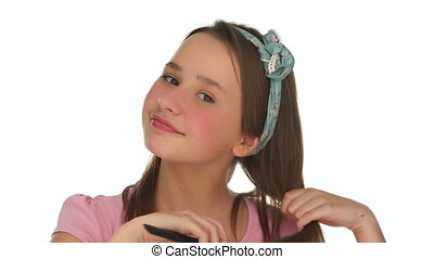 Pretty young girl playing with her brown hair
