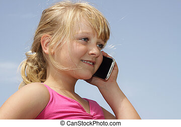 Pretty young girl talking on cell phone