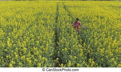 Pretty young girl walks and turns around in the rape field