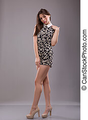 pretty young girl wearing in shotr dress with floral print