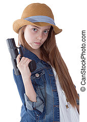 Pretty young girl with a hat sitting