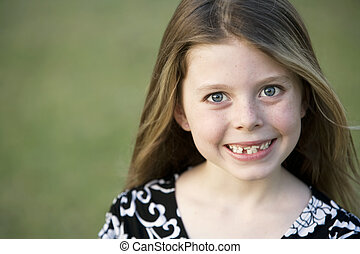 Pretty Young Girl with Crooked Teeth