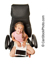 Pretty young girl with laptop sitting on a chair
