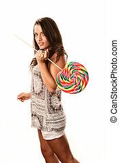 Pretty young Hispanic woman with lollipop