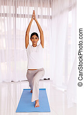 young indian woman doing fitness stretching