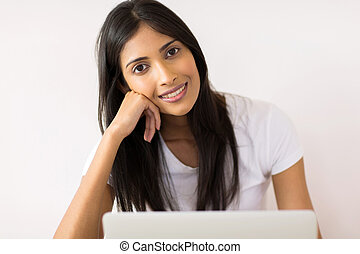 young indian woman looking at the camera