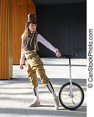 Pretty young lady in a fantasy clothes with unicycle...