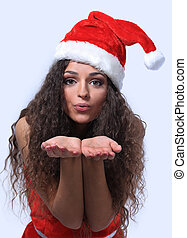 Pretty young lady in Santa Claus costume on white background