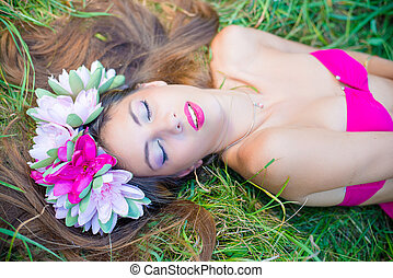 Pretty young lady in wreath with closed eyes
