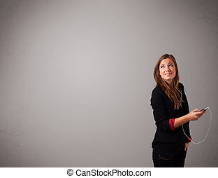 young lady singing and listening to music with copy space