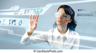 Pretty young lady using new technologies