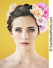 Pretty young lady with flower put in hair - Pretty young...